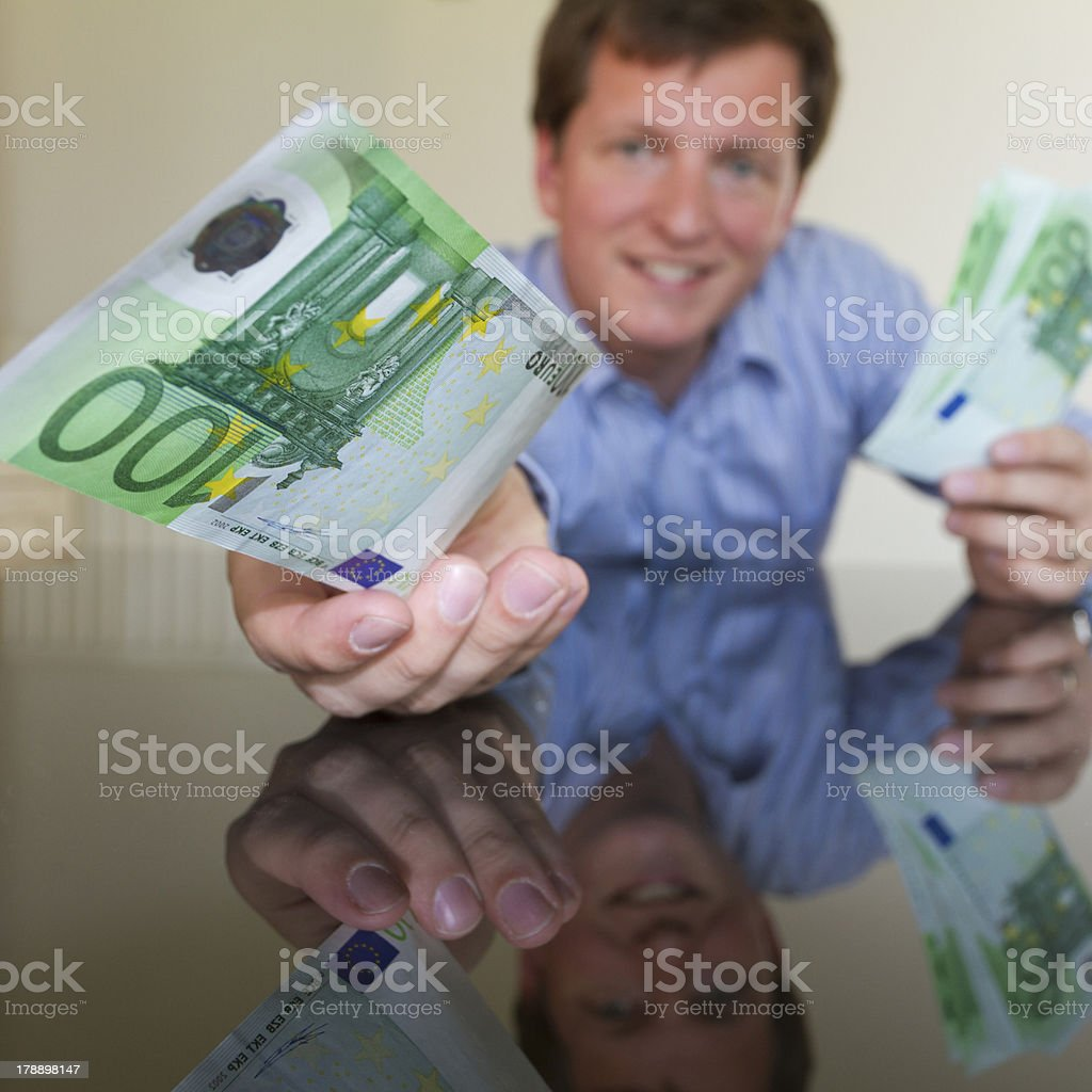 Giving 100 Euro (square) royalty-free stock photo