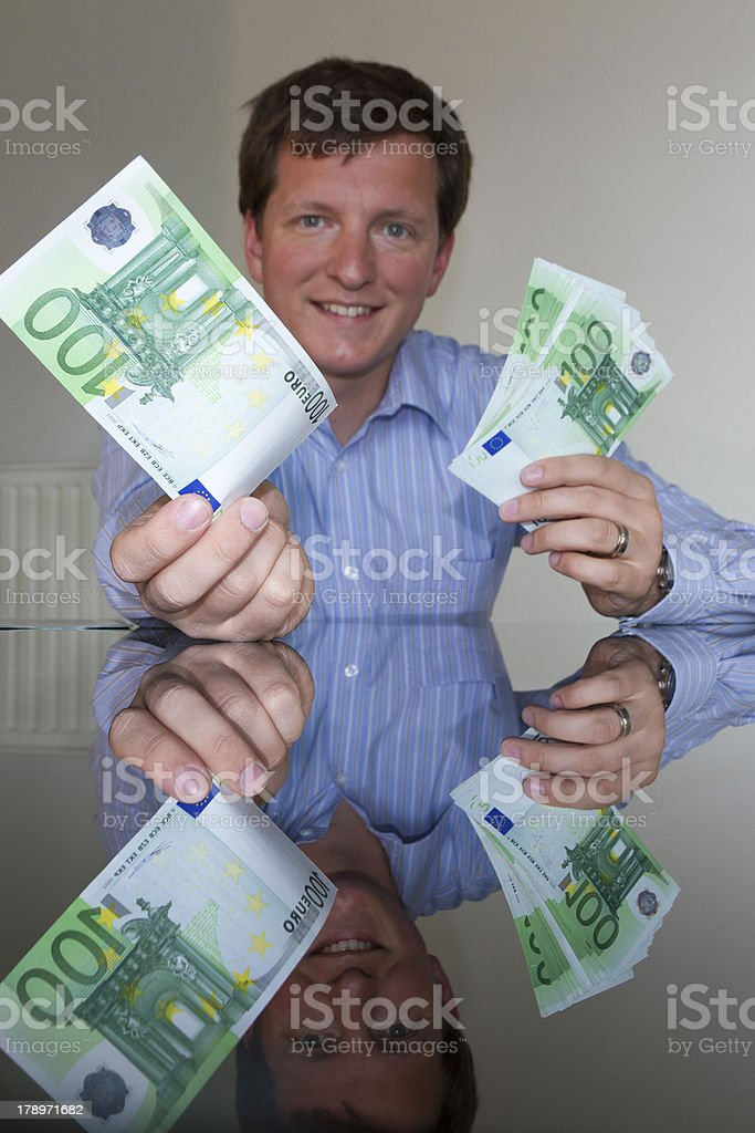 Giving 100 Euro (vertical) royalty-free stock photo