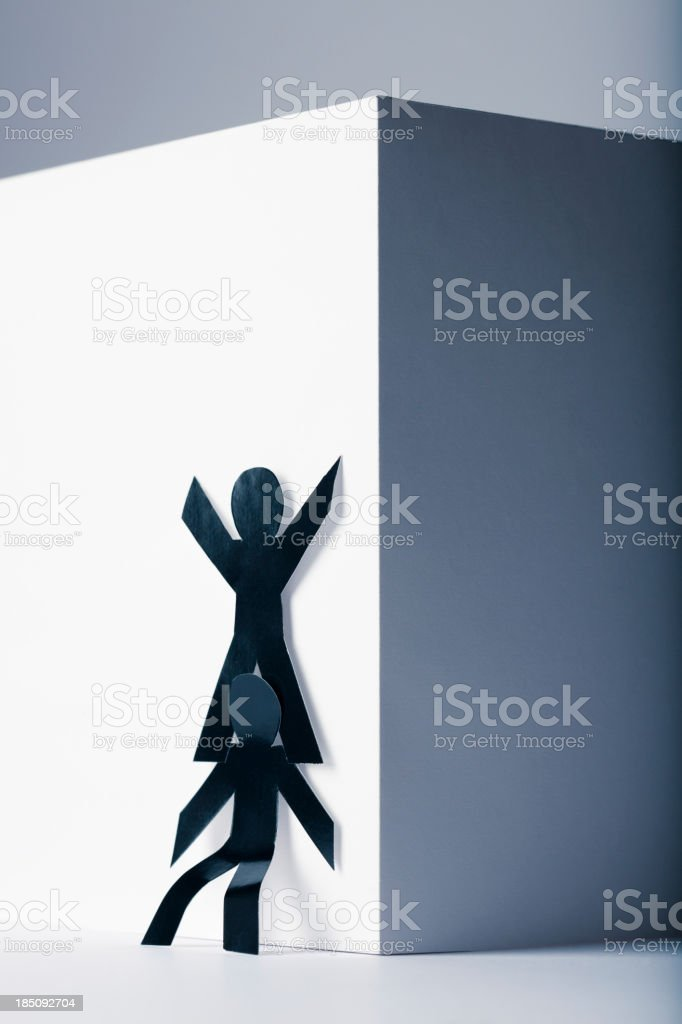 Giving a boost up - paper person concept of assistance royalty-free stock photo