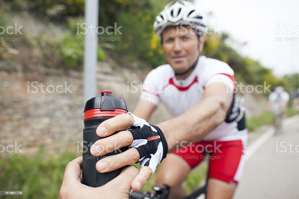 Giving a cycle bottle stock photo