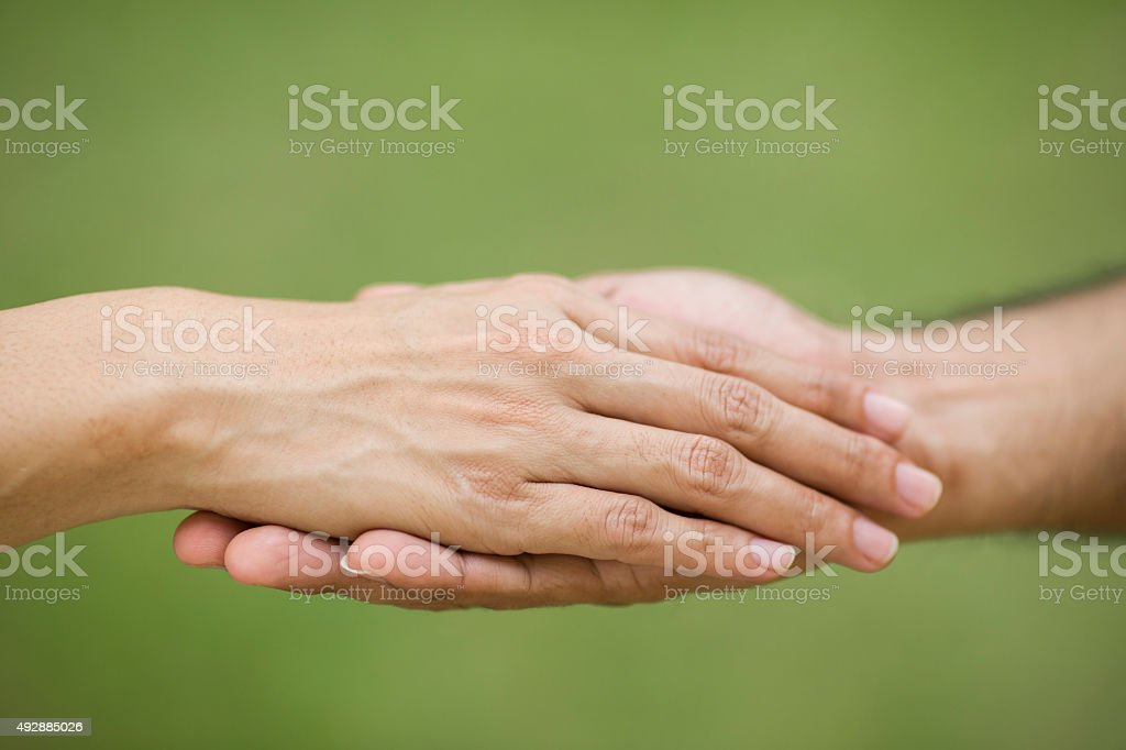 Giving a helping hand to another stock photo