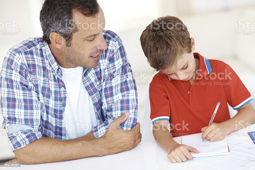 Giving a helping hand with his homework royalty-free stock photo