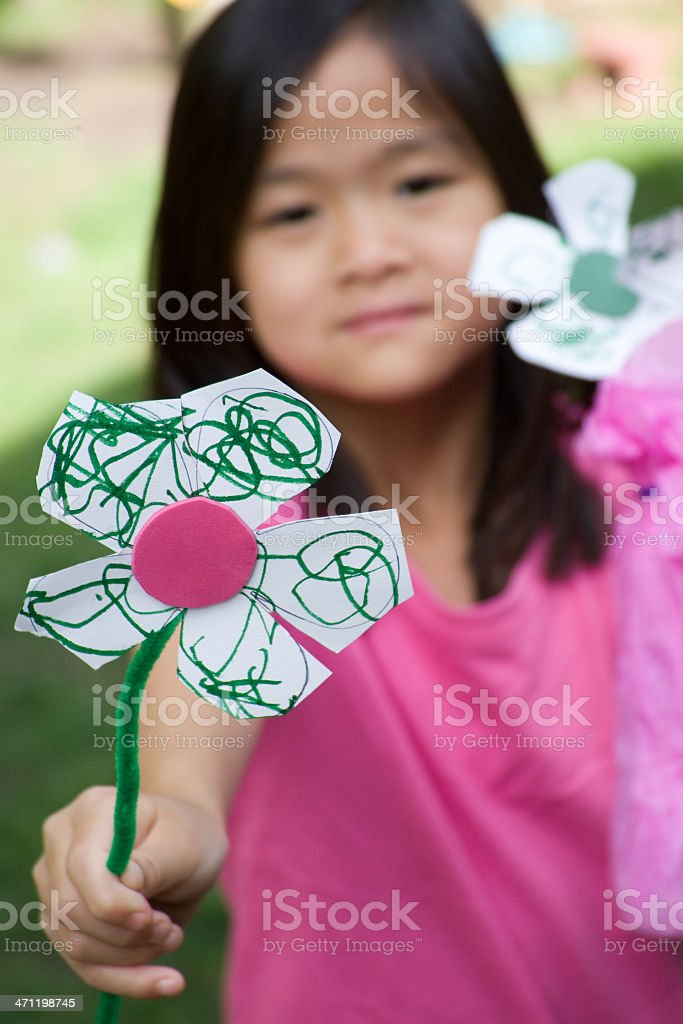 Giving a homemade flower royalty-free stock photo