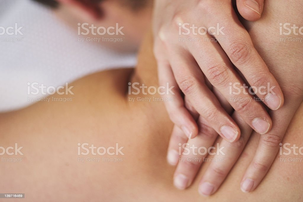 Giving a massage royalty-free stock photo