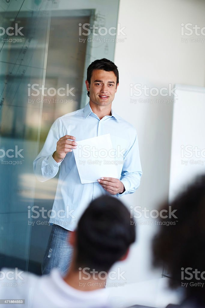 Giving a presentation to his coworkers royalty-free stock photo