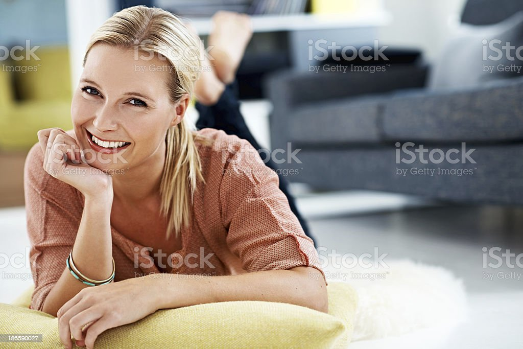 Giving a relaxed and content smile royalty-free stock photo