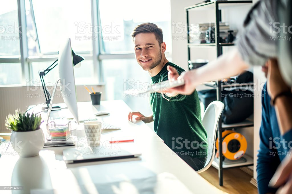 Giving a tablet stock photo