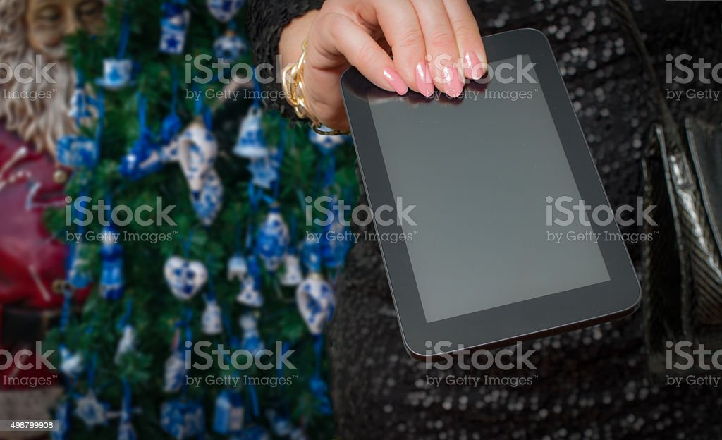 giving a tablet with Delfts Blue in the Christmas tree stock photo