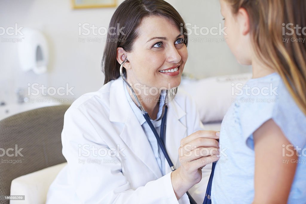 Giving a thorough check-up royalty-free stock photo