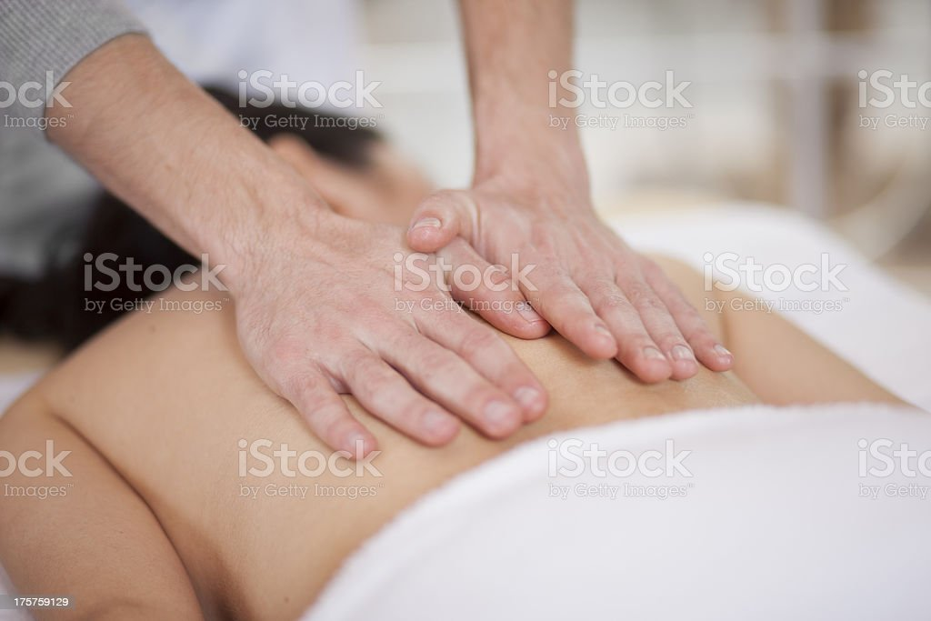 Giving back massage to a chubby woman royalty-free stock photo