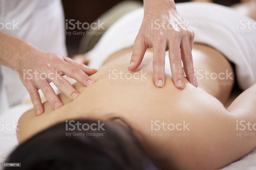 Giving back massage to a client royalty-free stock photo