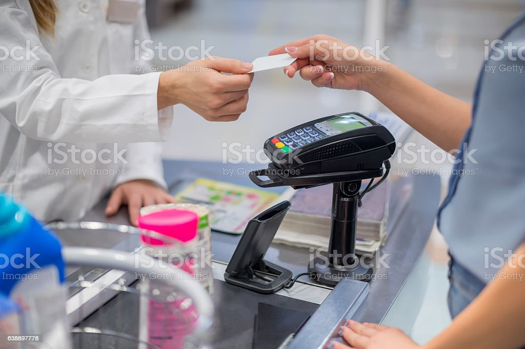 Giving credit card to cashier stock photo