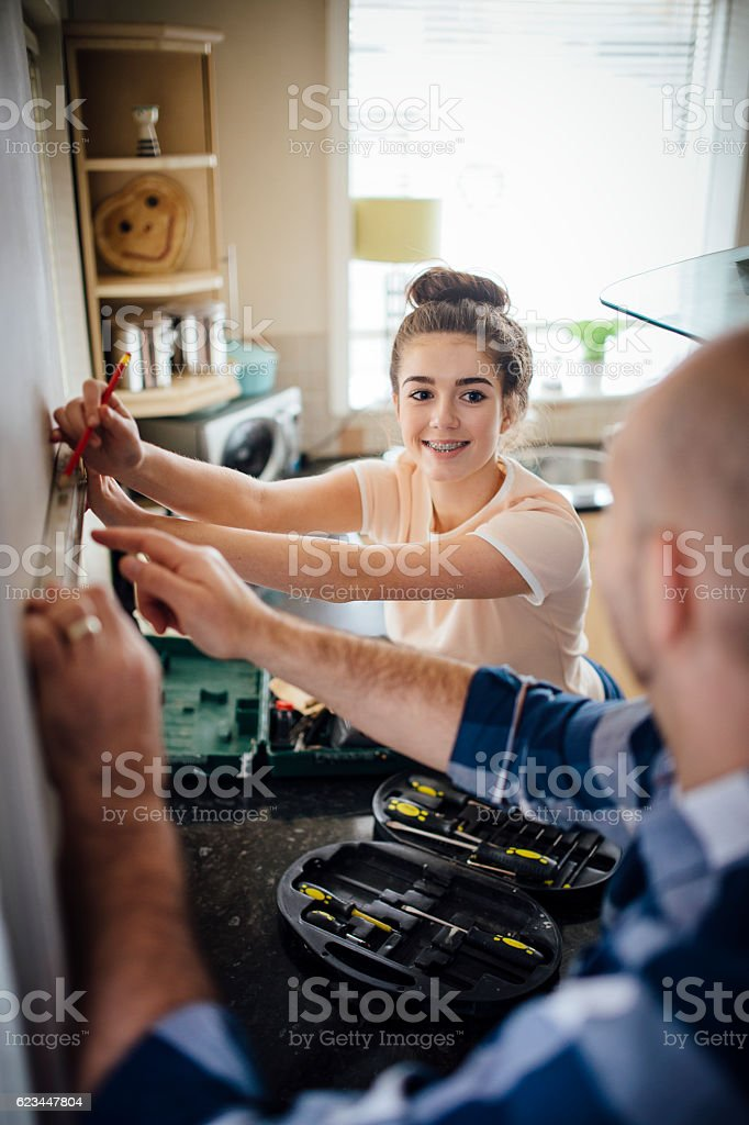 Giving Dad a Hand with DIY stock photo