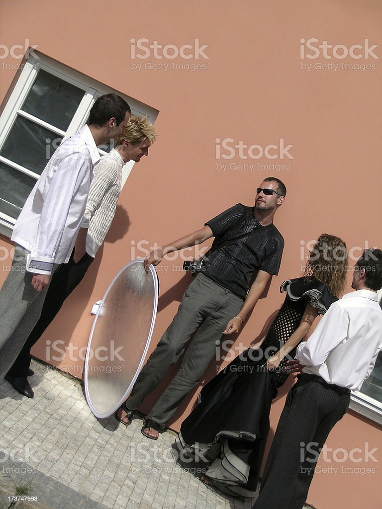 Giving directions to models stock photo