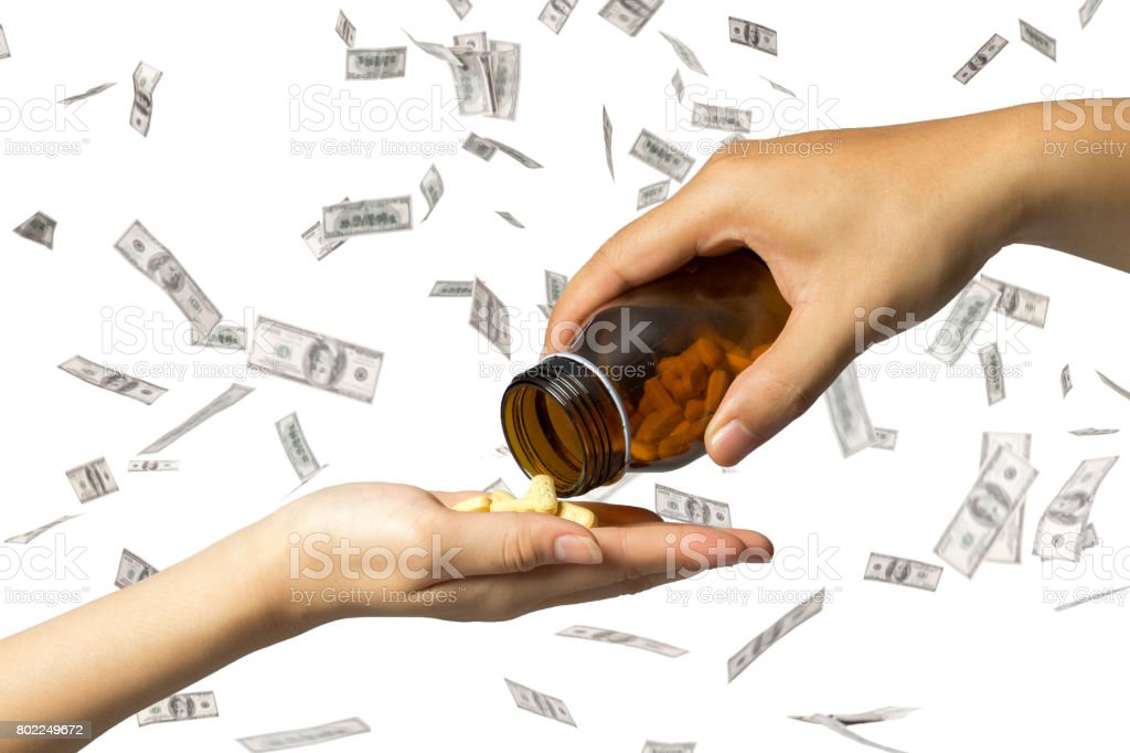 giving drugs hand to hand, dollars motion action on background. stock photo