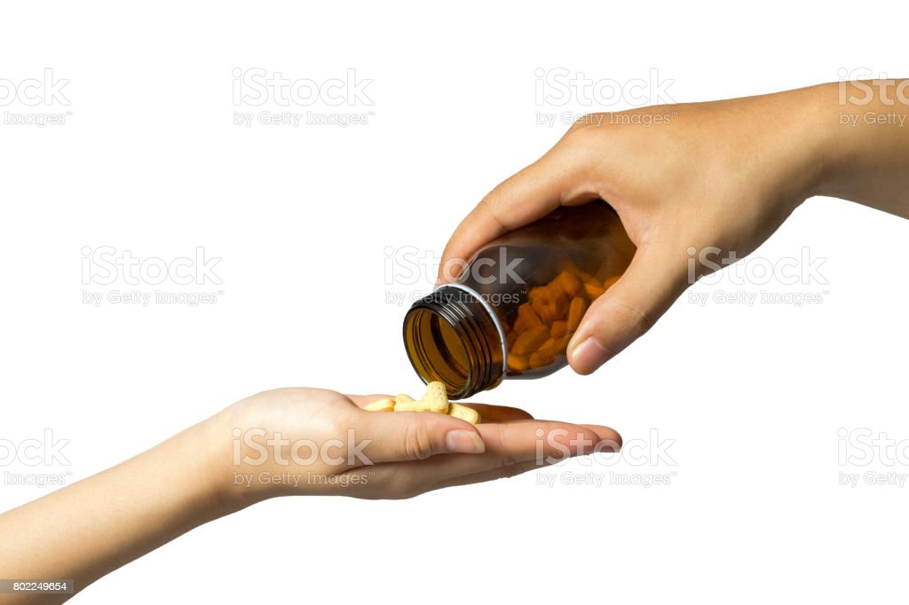 giving drugs hand to hand, white background. stock photo