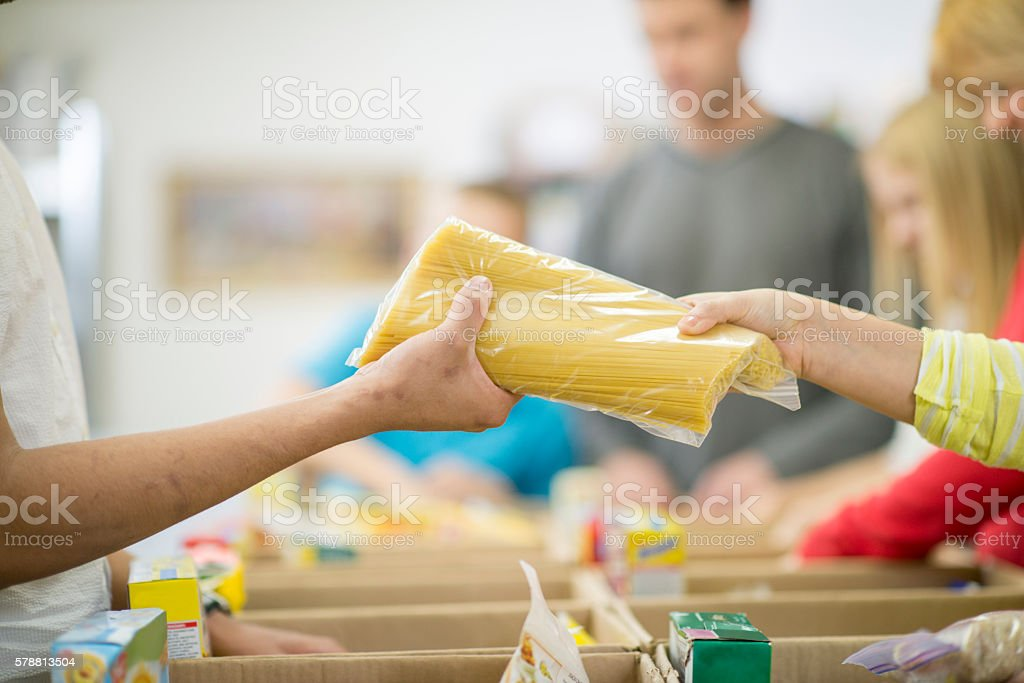 Giving Food for the Homeless stock photo