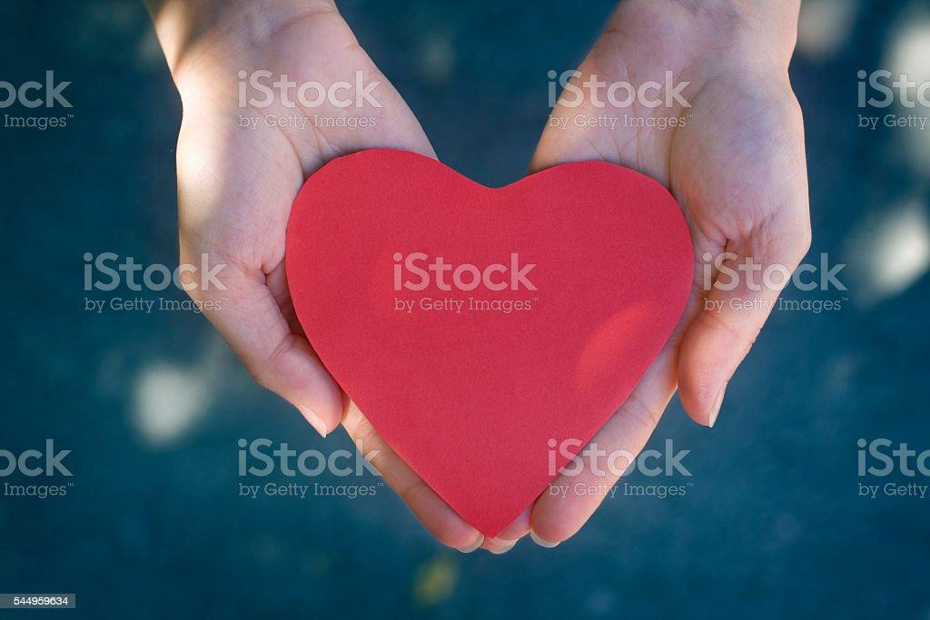 Giving heart stock photo