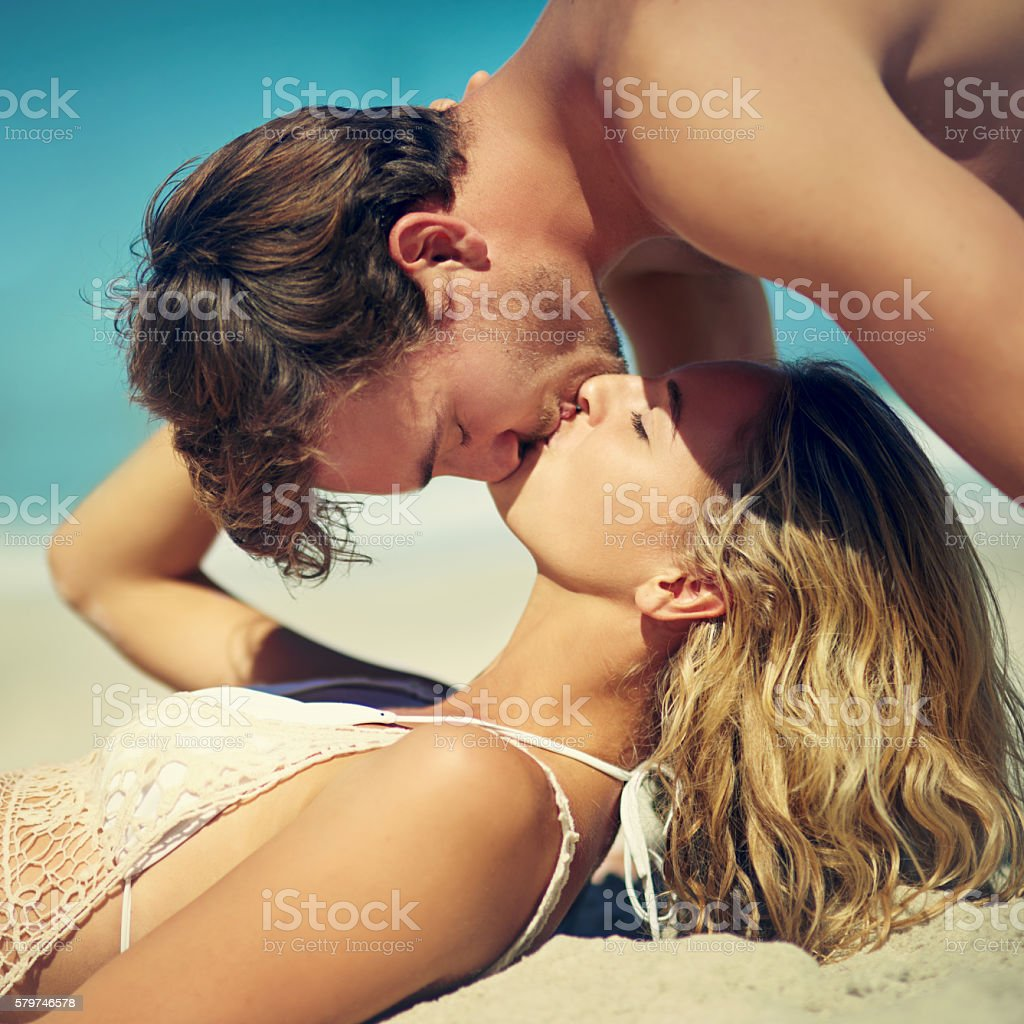 Giving her a surprise kiss stock photo