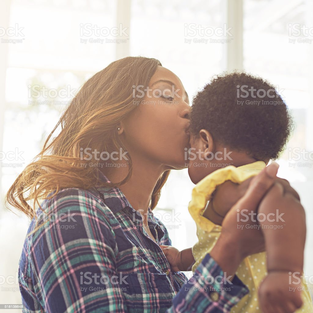 Giving her baby all the love she needs stock photo