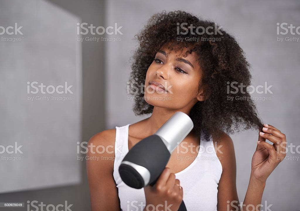 Giving her hair the full course treatment stock photo