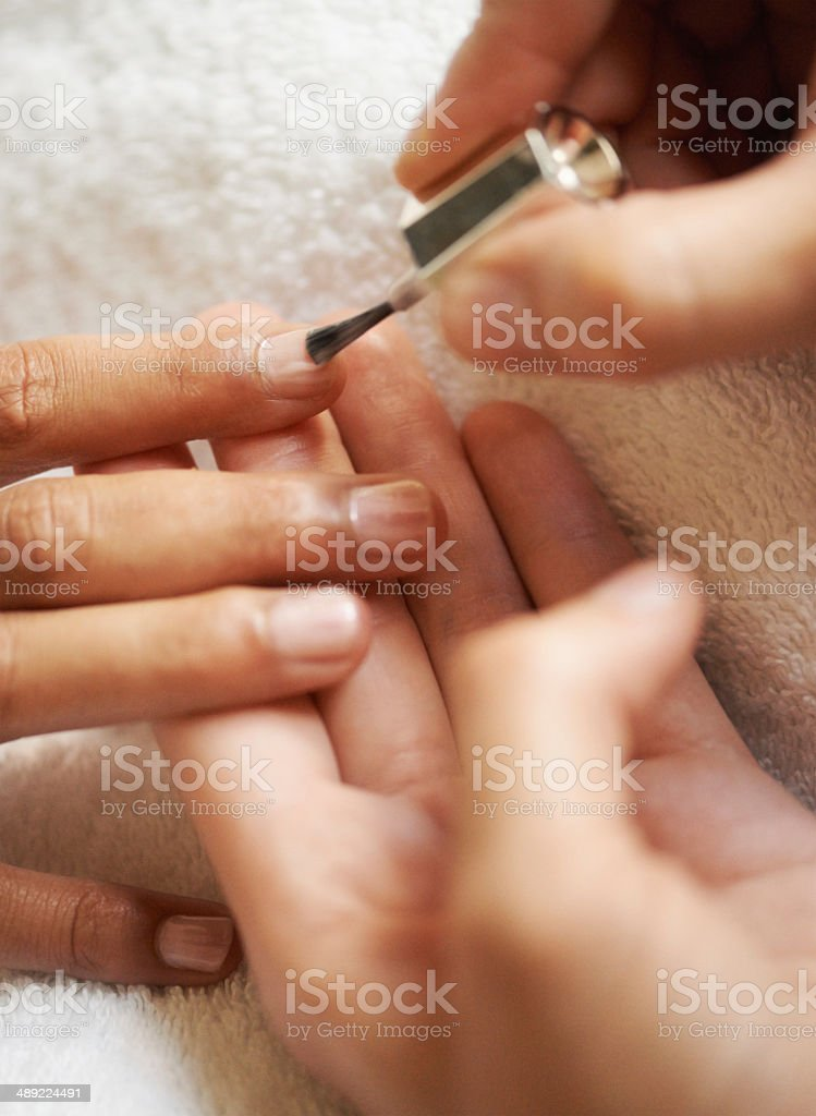Giving her nails some well deserved attention royalty-free stock photo