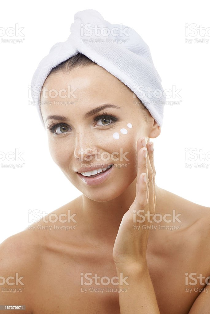 Giving her skin the moisture it needs royalty-free stock photo