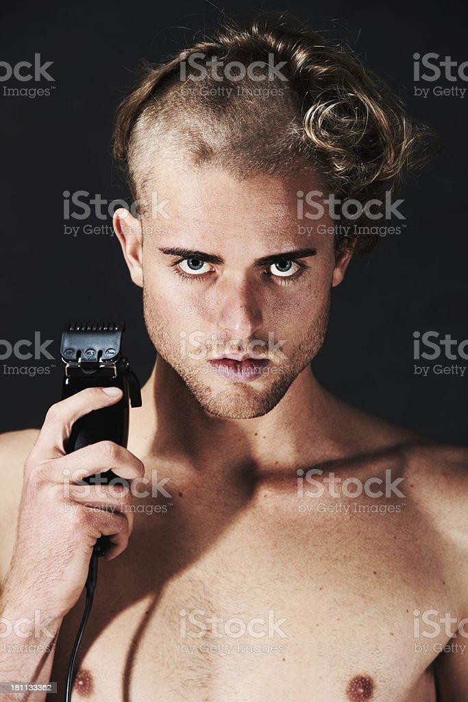 Giving himself a drastic haircut royalty-free stock photo