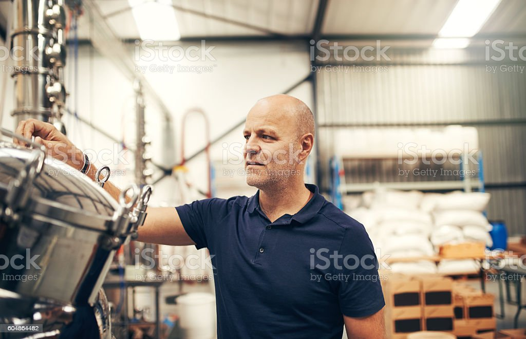 Giving his batch some tlc stock photo
