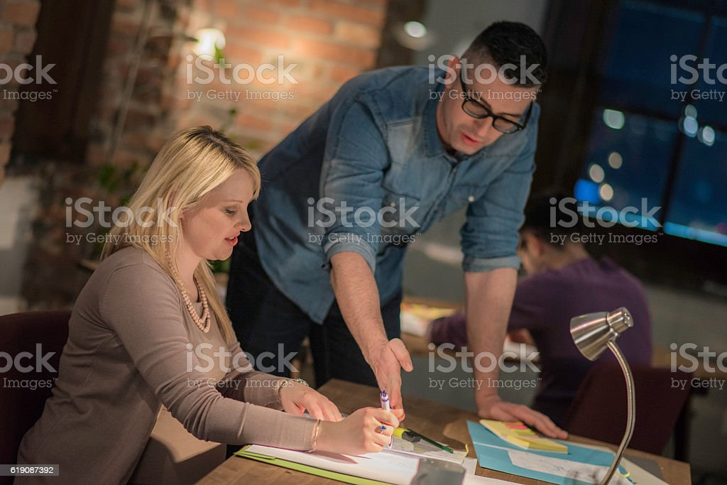 CEO giving instructions to employee stock photo