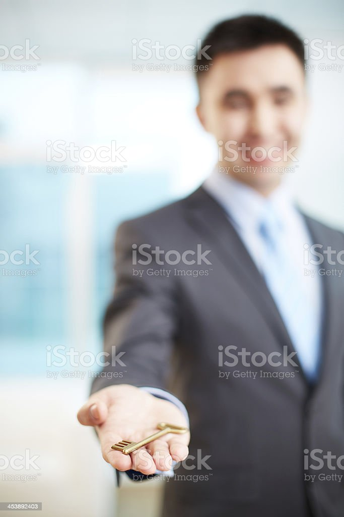 Giving key royalty-free stock photo