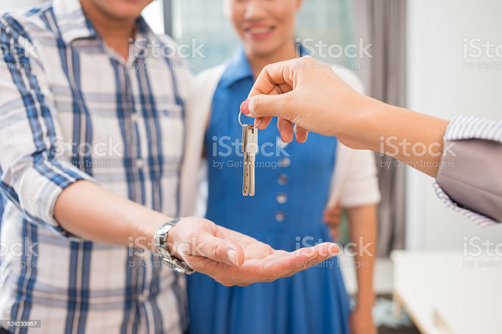 Giving keys stock photo