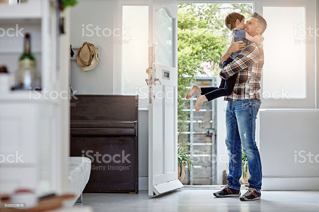 Giving my boy a bear hug after a long day... stock photo