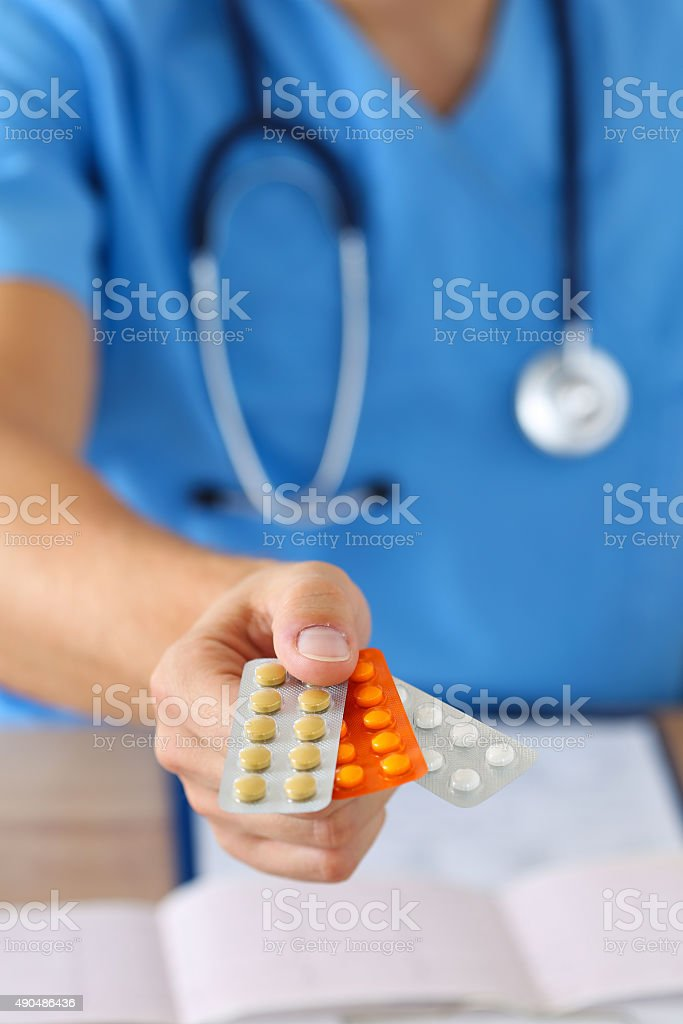 Giving or showing medications to patient stock photo