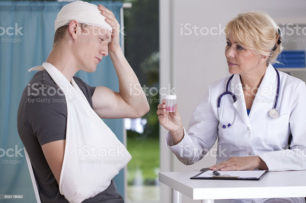 Giving pills for headache stock photo