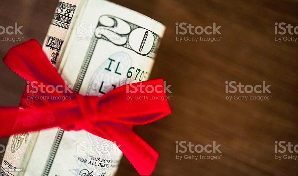 Giving the gift of cash at Christmas stock photo