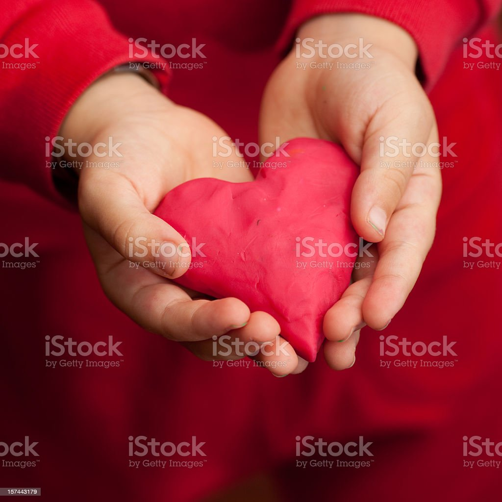 giving the heart royalty-free stock photo