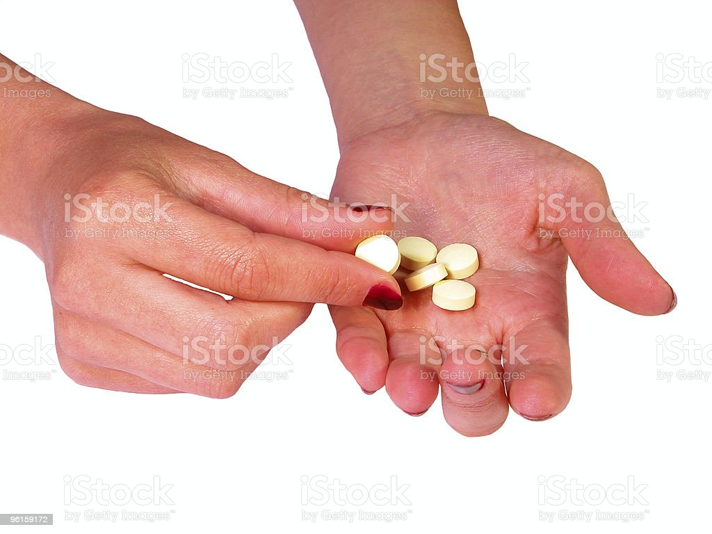 Giving the pills royalty-free stock photo