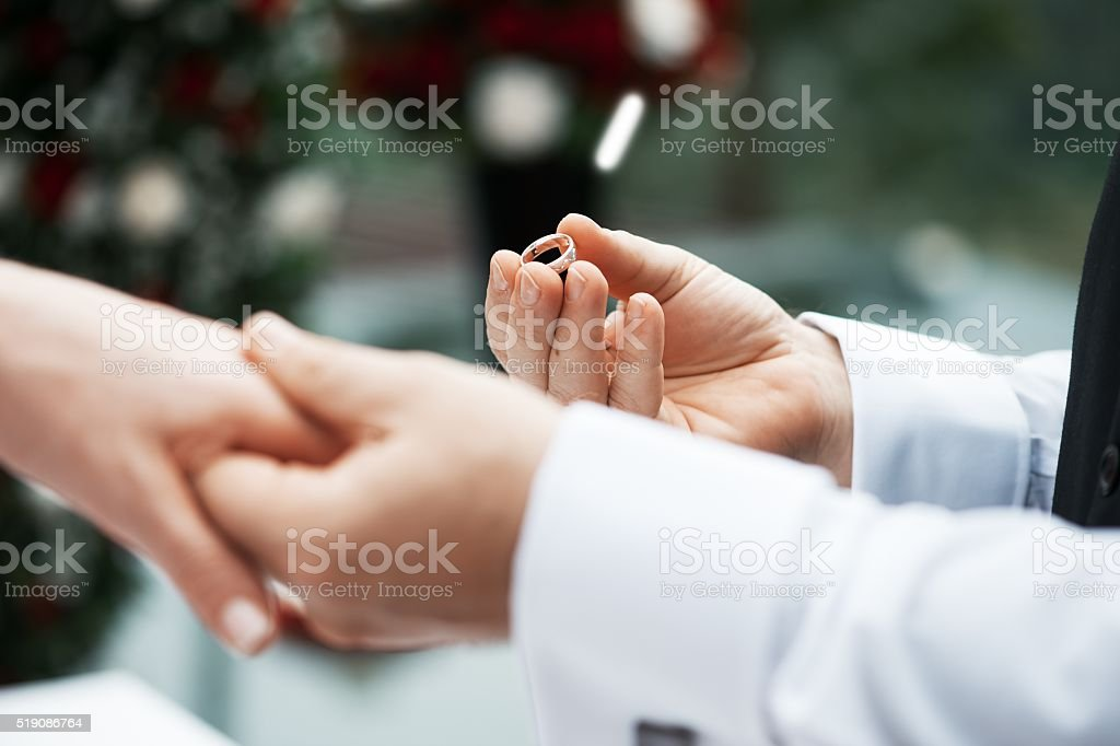 Giving the ring to the bride. stock photo