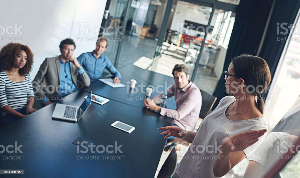 Giving the team a note from her professional pages stock photo