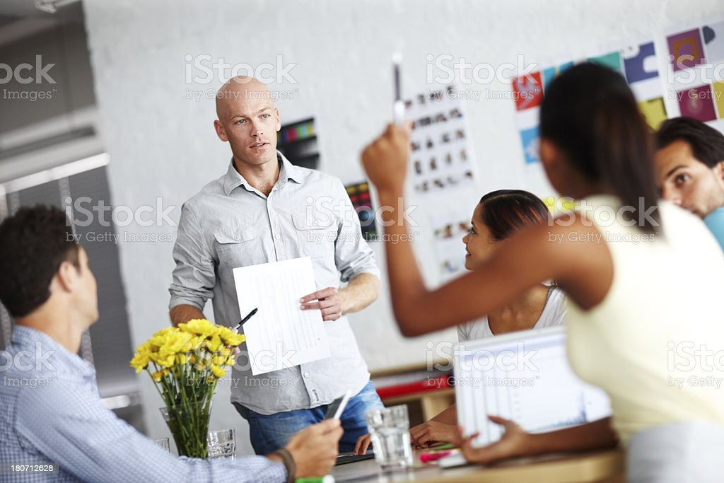 Giving them the breakdown royalty-free stock photo