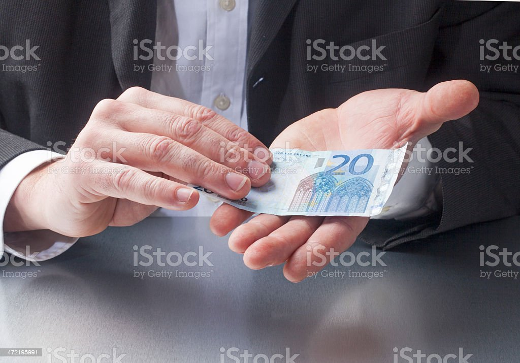 giving twenty euros for a deal royalty-free stock photo