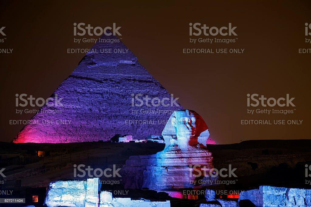 Giza pyramid and Sphinx illuminated at night stock photo