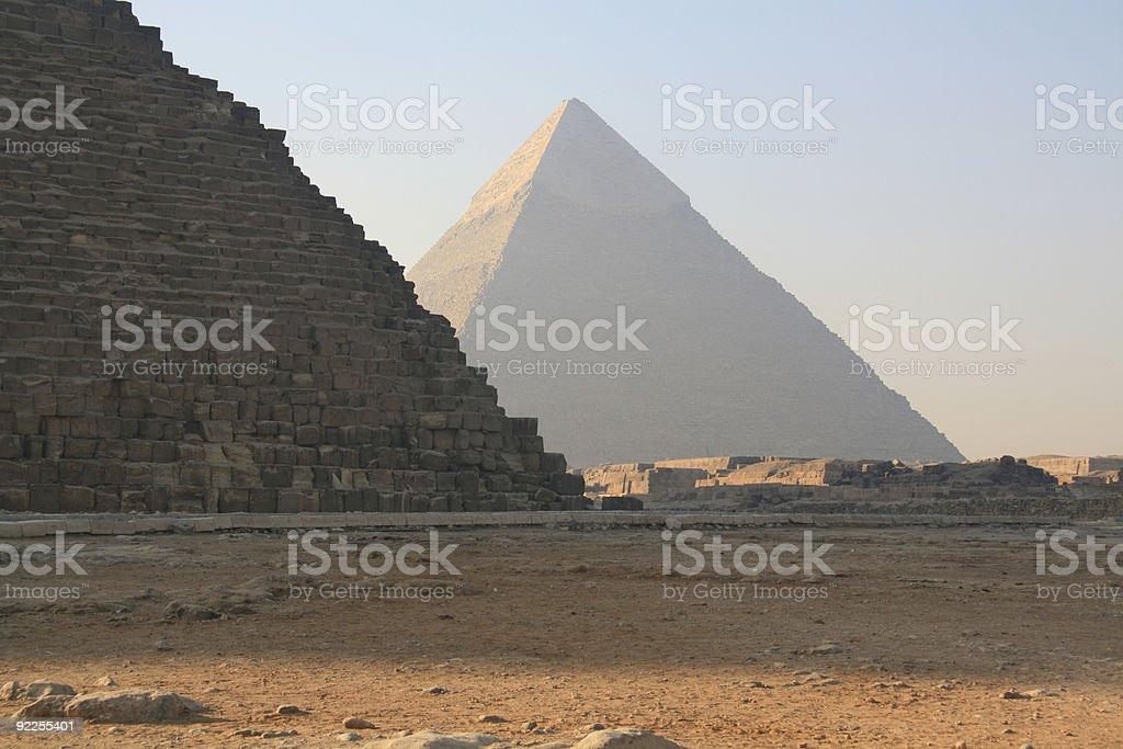 Giza Pyramids in fog stock photo
