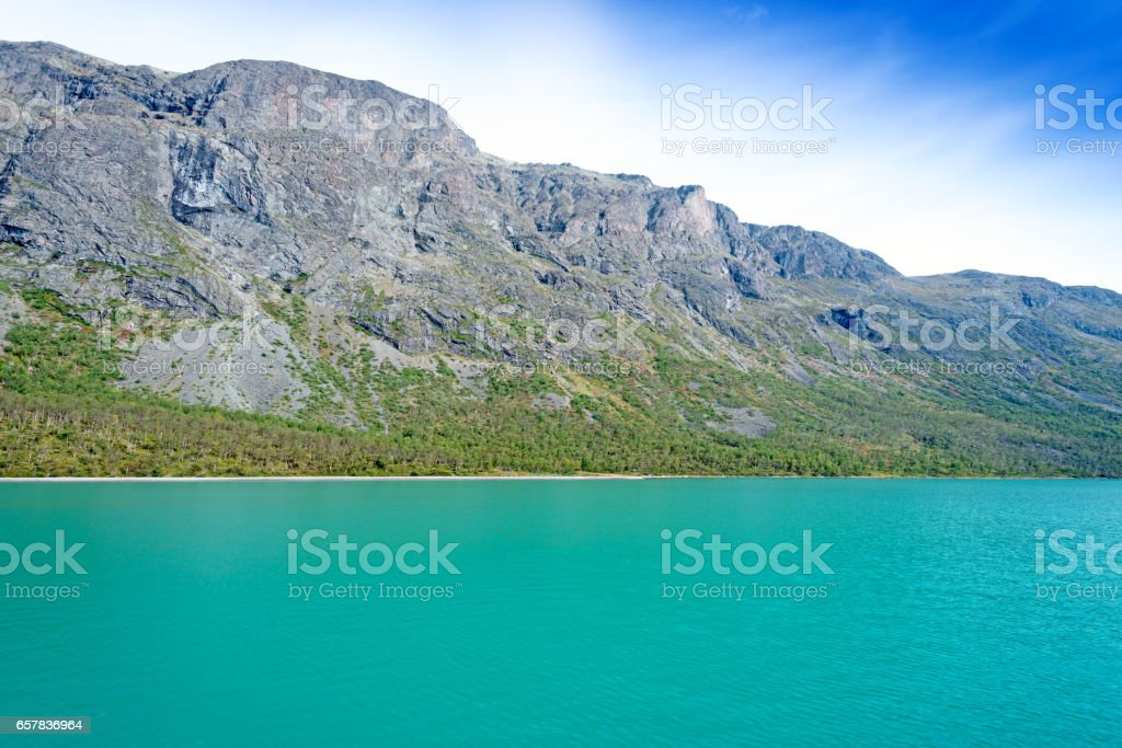 Gjende is a lake in the Jotunheimen mountains view from ferry stock photo