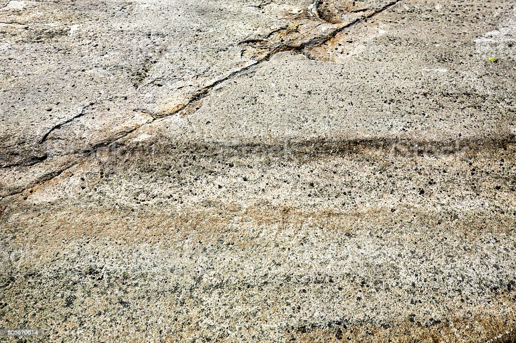 Glacial grooves in granite bedrock, legacy of the ice age. stock photo