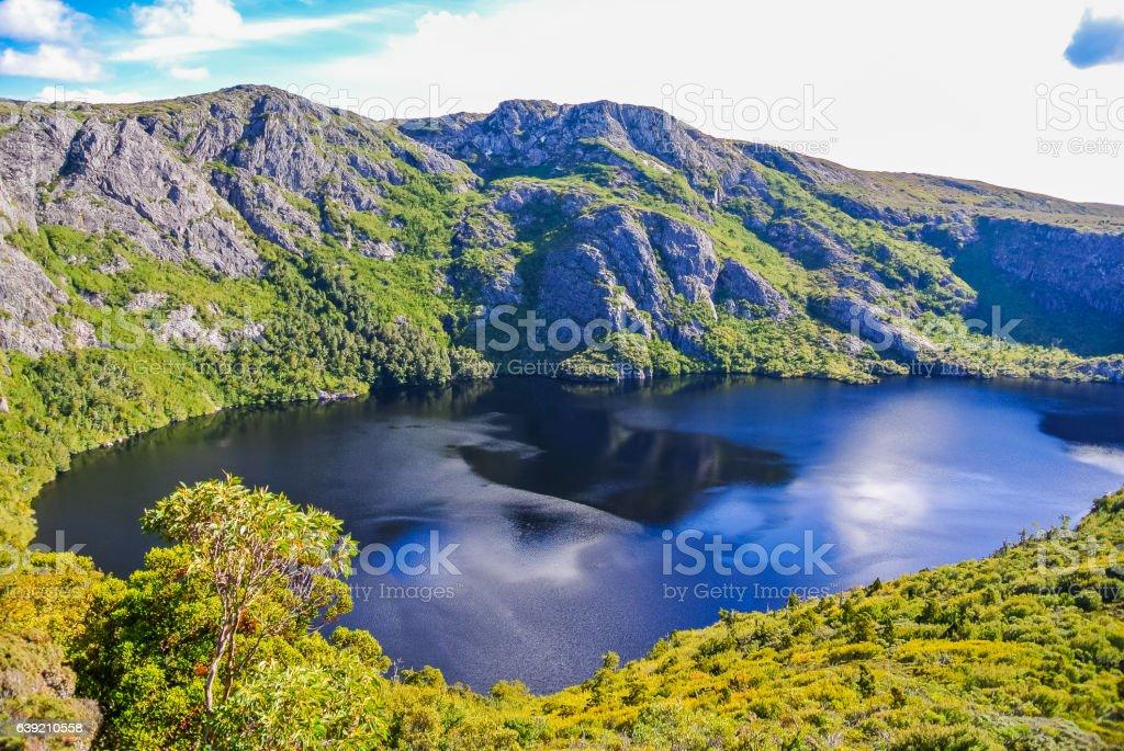 Glacial lake and rugged mountains at Cradle Mountain, Tasmania stock photo