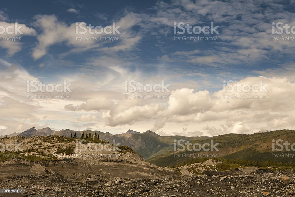 Glacial moraine with clouds royalty-free stock photo
