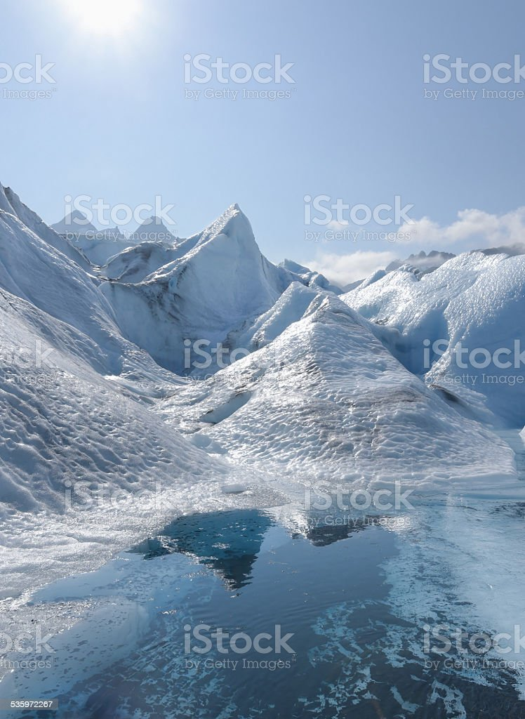 Glacial pool with ice field in background stock photo