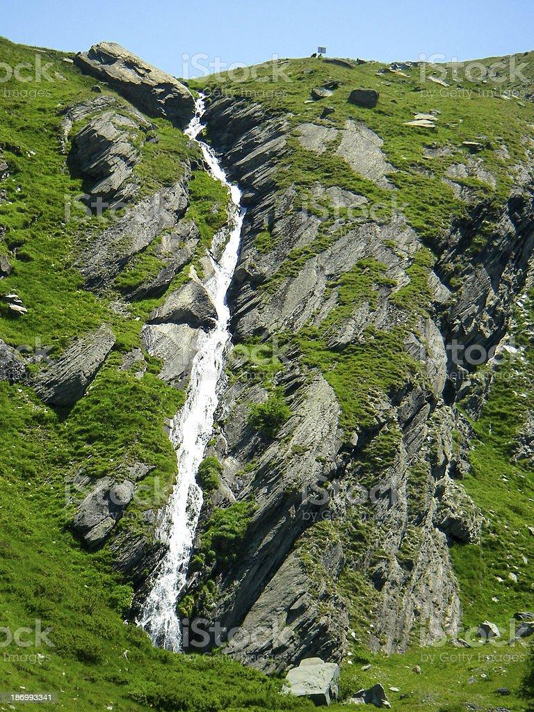 Glacial Waterfall in the Swiss Alps near Zermatt Switzerland stock photo